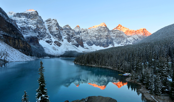 The sun rises over Moraine Lake