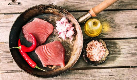 Ahi tuna sears in a pan